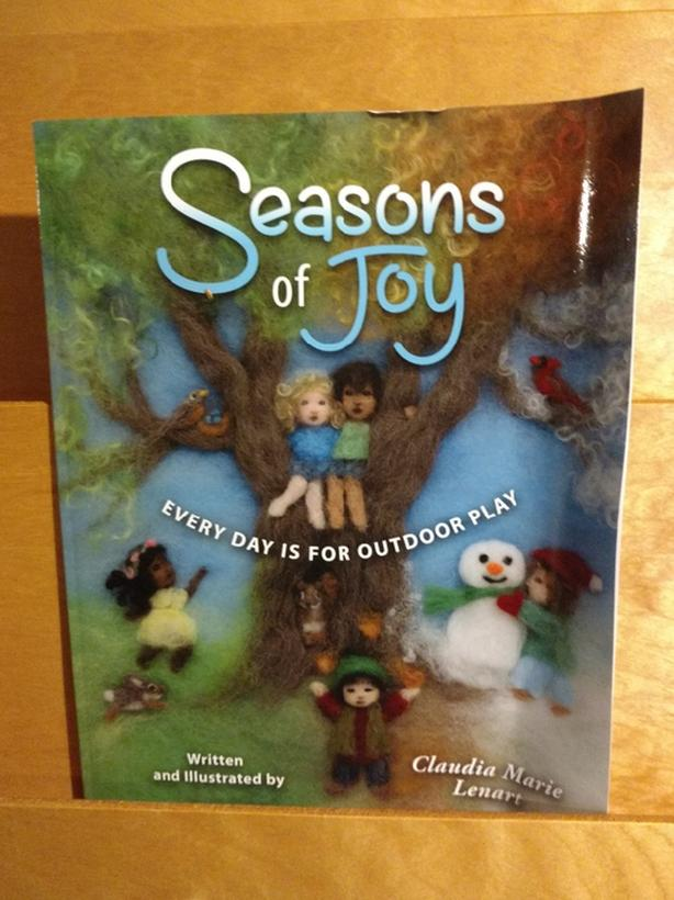 Seasons of Joy story book.  Pages of actual felted scenes.