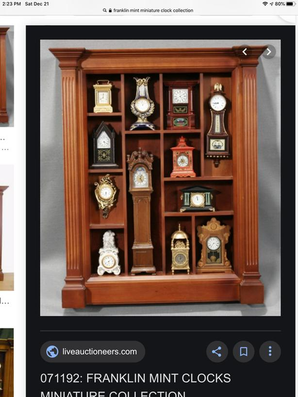 FRANKLIN MINT MINIATURE CLOCK COLLECTION AND CABINET