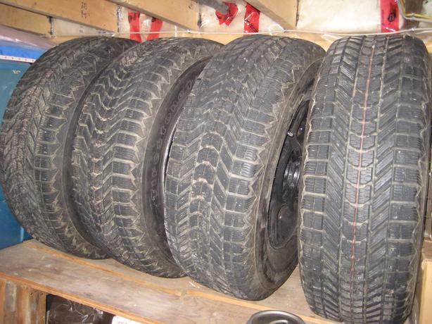 P255 70 R16 firestone winter tires on rims.