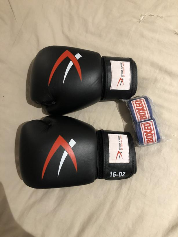 New 16 oz boxing gloves with new wraps