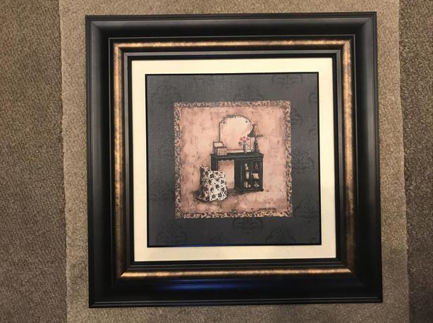Nicely framed artistic piece.