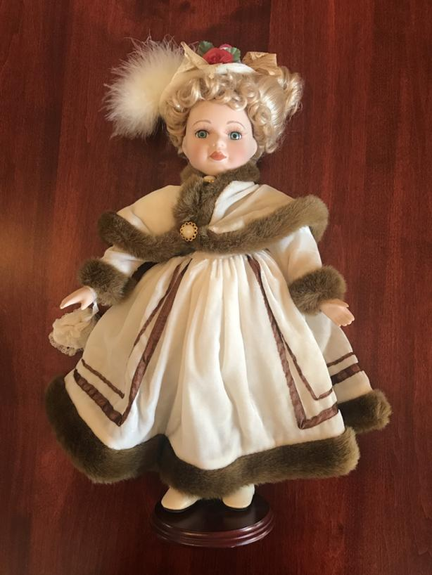 """Collectible Vintage Era Doll - 18"""" tall on display stand."""