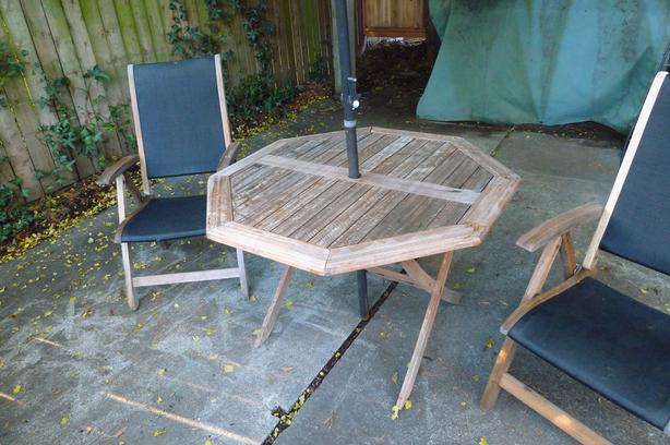 Teak Table and Reclining Folding Chairs