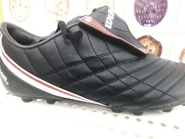 Branded soccer cleats