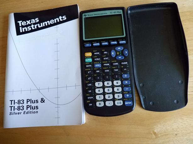 Texas Instruments TI-83 Plus Graphing Calculator w. Manual