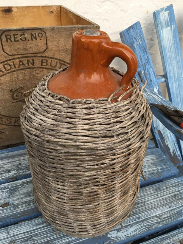 VINTAGE STONEWARE JUG WITH RATTAN COVERING