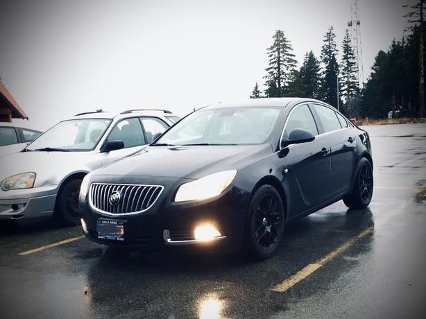 Buick Regal CXL - Sedan 4 Door Black with mat black rims.