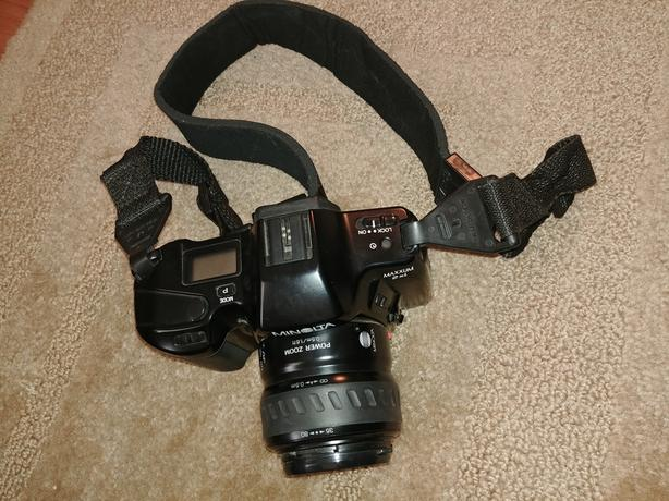 Minolta camera with flash and cases