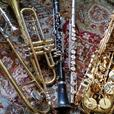 Serviced alto, tenor saxophones