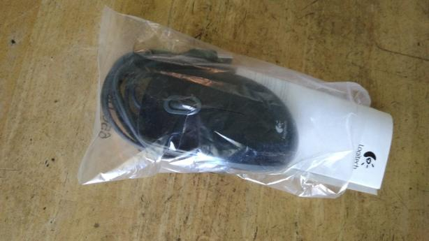 corded logitech mouse, brand new with manual