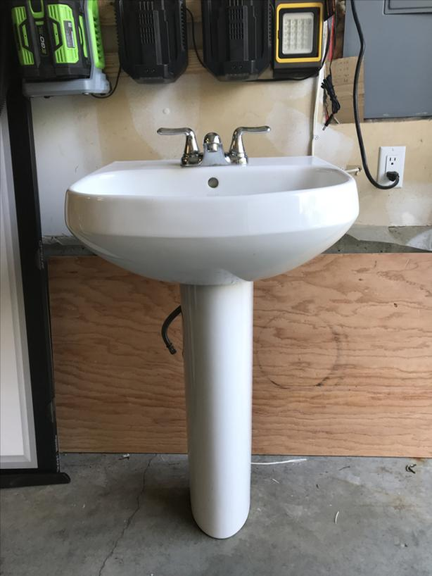White Pedestal Sink and Tap
