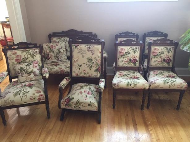 6 antique covered chairs and 1 love seat.