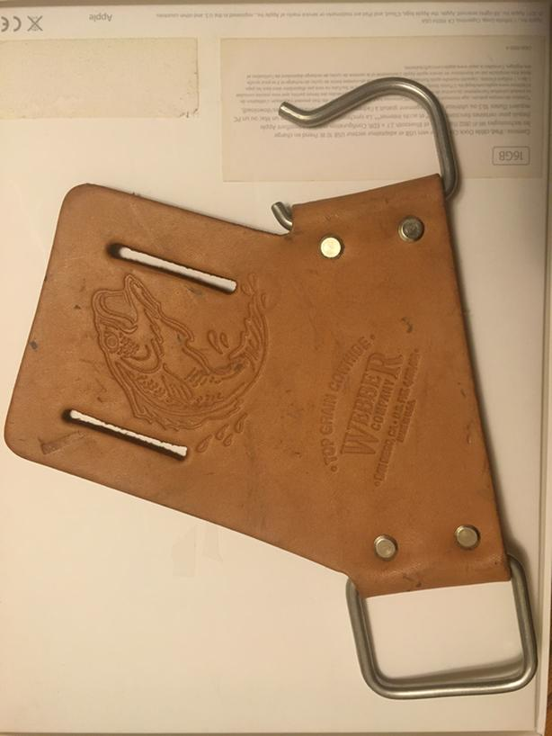 A fishing rod holster having a flat base with belt attaching slots