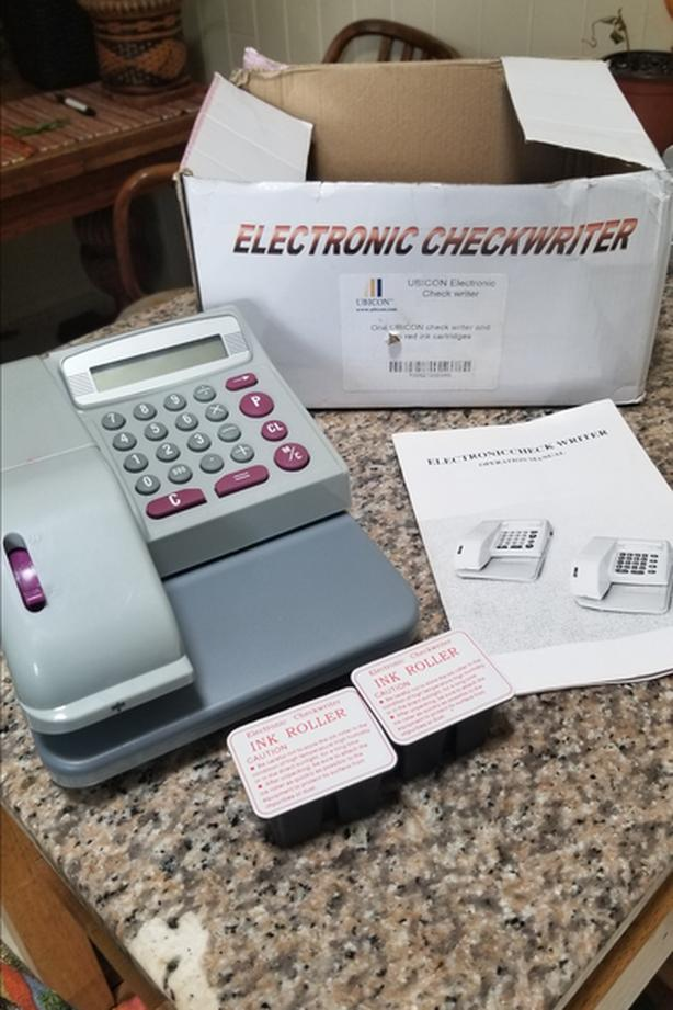 UBICON ELECTRONIC CHEQUE WRITER
