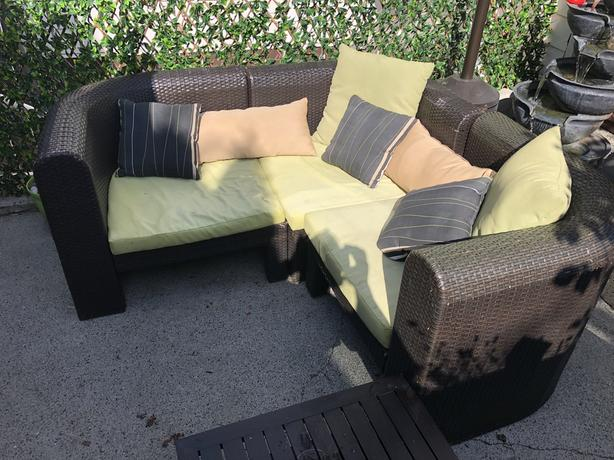 Cool looking sectional with pillows  will DELIVER.