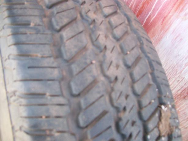 TWO TIRES ONE ON STEEL RIM