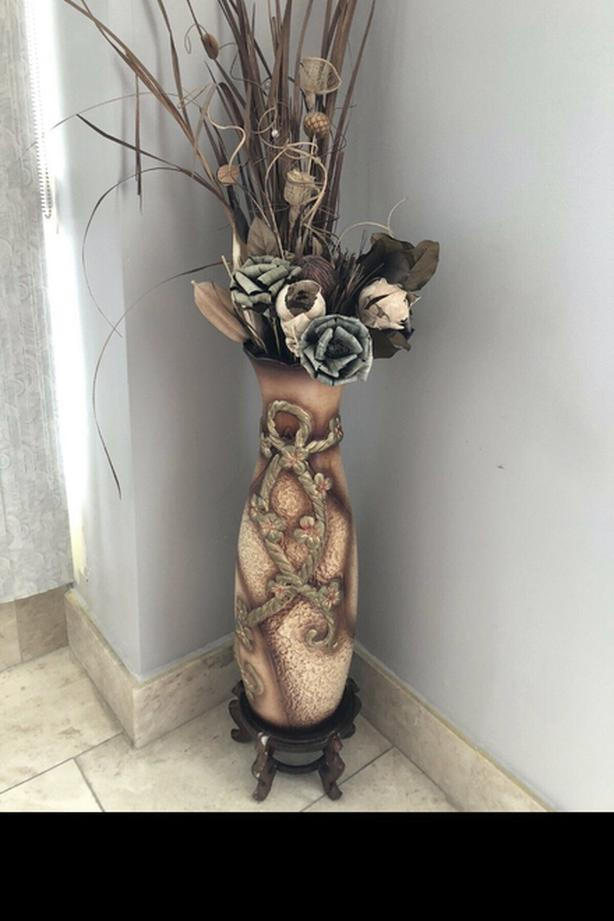Vase with flowers and stand