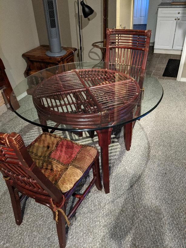 Heavy Glass Round Table with wicker base and chairs