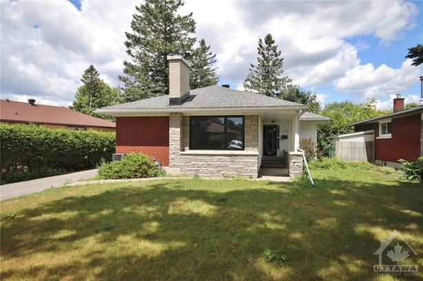 Beautiful cozy brick/stone bungalow situated on a large lot!