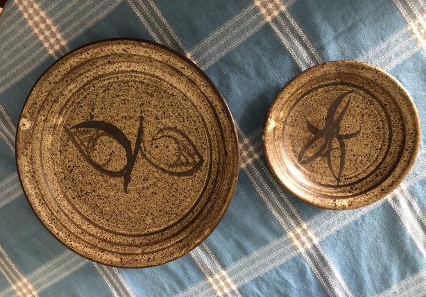 2 beautiful pottery plates