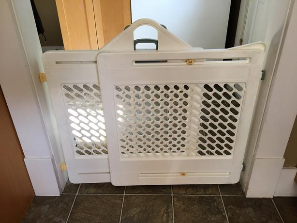 Fisher Price white adjustable safety gate