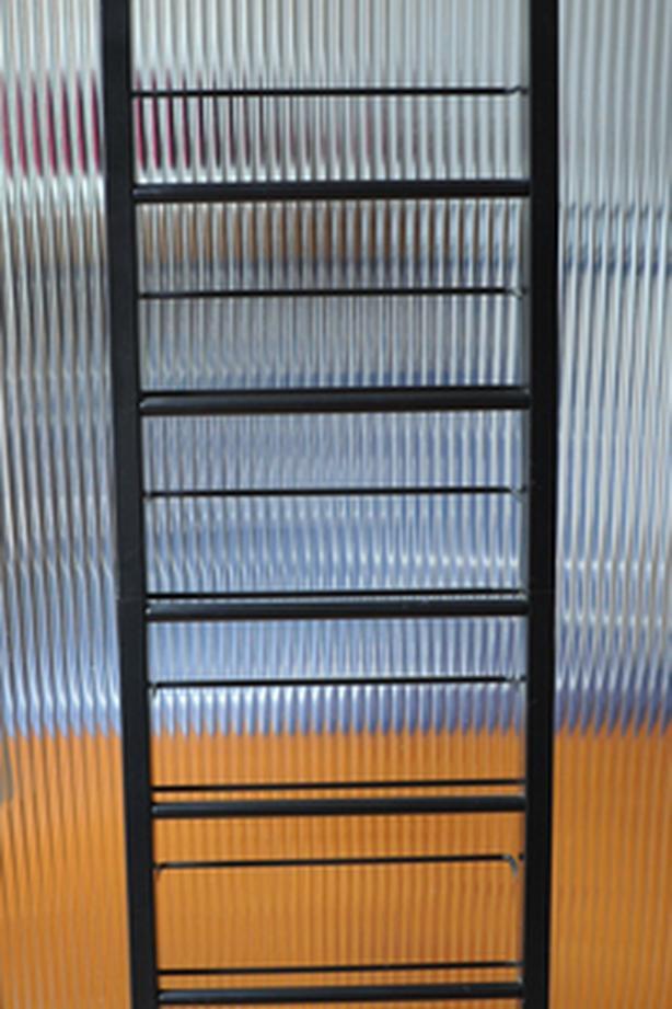 metal rack on wheel for CD or towels