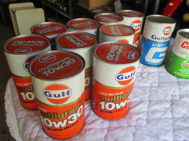 VINTAGE UNOPENED OIL CANS FROM ESTATE