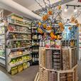 Gourmet grocery store, fruits and vegetables, cooked meals, Very good income