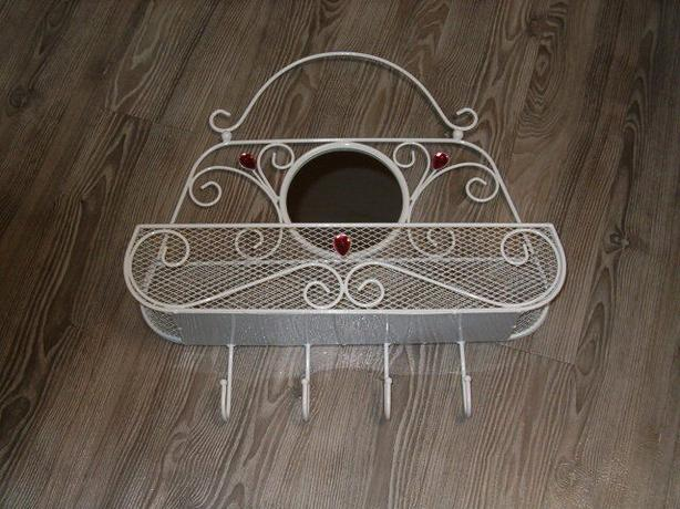 wall clothing rack , metal purse with a mirror