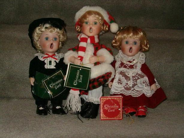 Christmas carolers dolls porcelain for the set three doll