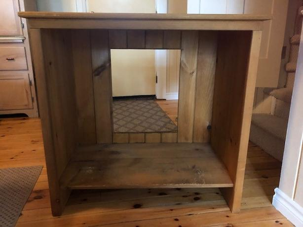 wood shelving unit or table - top of a TV unit