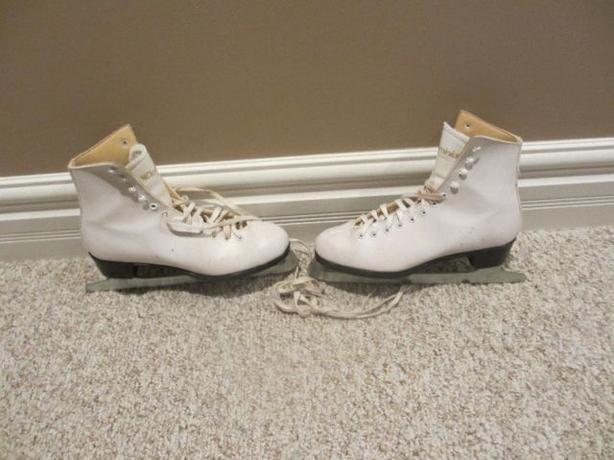 Ladies white figure skates:  Sizes 8 and Size 9