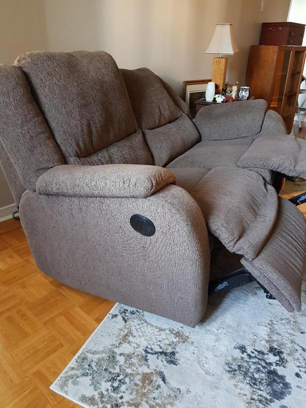 NEW PRICE! Power Reclining Love Seat valued at $3,500
