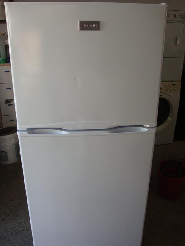 "Frigidaire Apartment size fridge, 24"" wide and 60"" 1/4"" height"