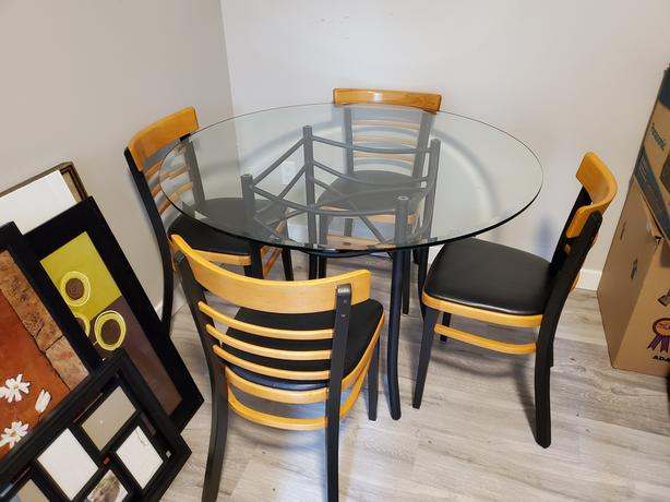 42 inch glass dinning table and 4 chairs