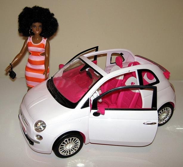 Barbie Doll and White Convertible Car