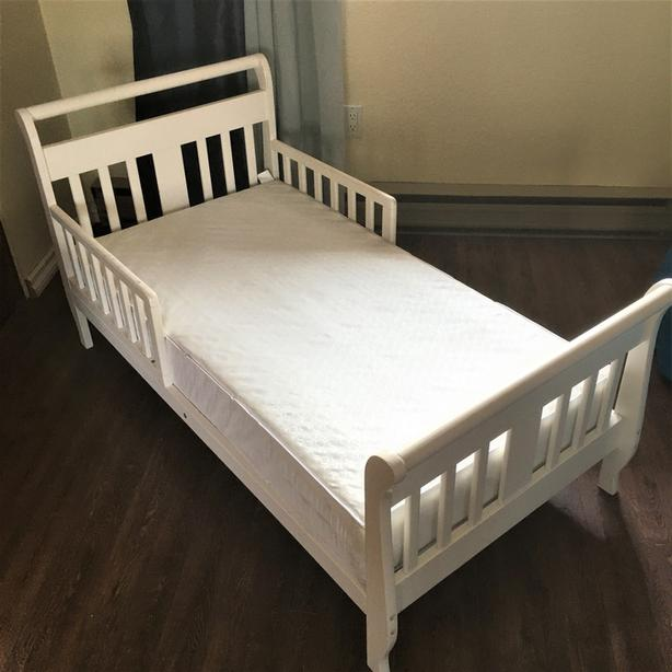 Lovely, white, solid wood child's bed with mattress