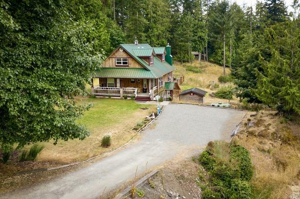 A peaceful hollow plus a rental suite and so much more