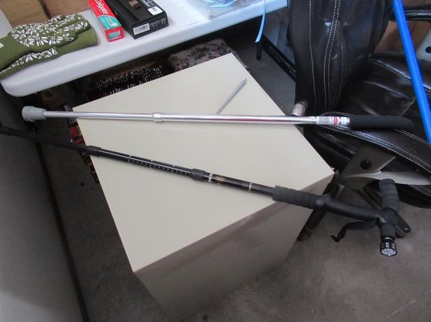 2 walking canes- sell each- 1 has an LED flashlight attached