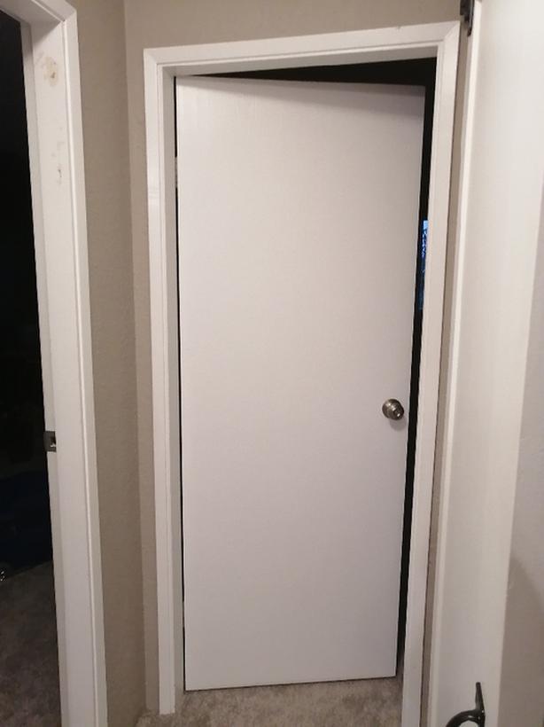 White door with hardware