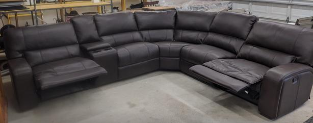 Like new brown leather reclining couch
