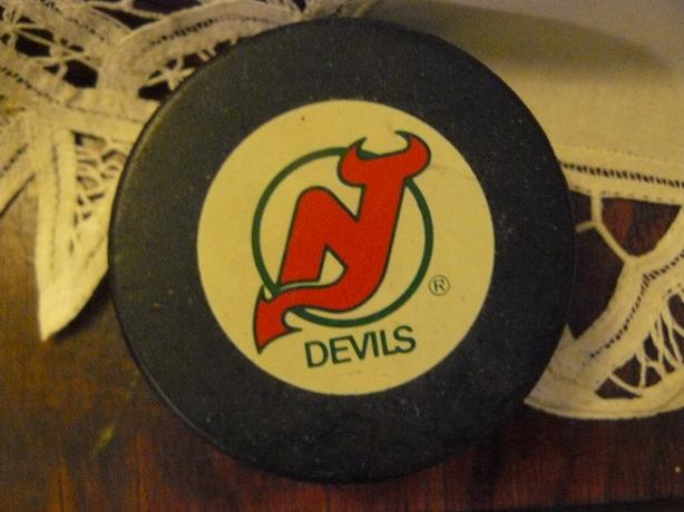vintage new jersey hockey puck