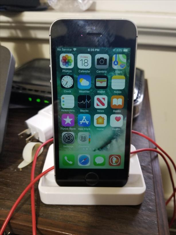 iPhone 5s with charging stand
