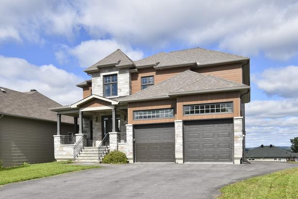 Beautiful and spacious home with numerous upgrades !