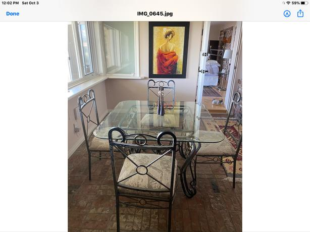 Stoney Creek rod iron, glass top table and four chairs