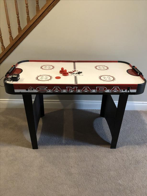 Kids air hockey table