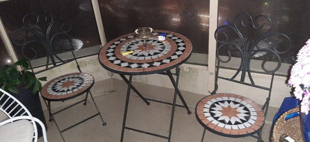 Cast iron patio set with tile mosaic pattern