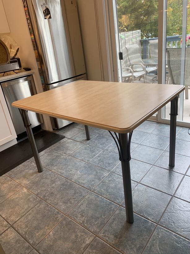 Kitchen dining table with extra leaf