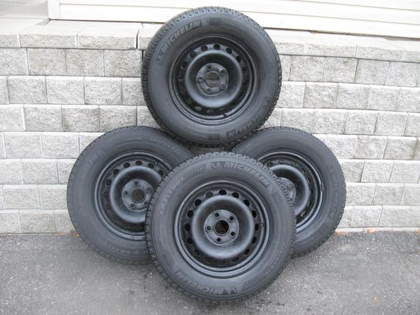 FOUR  (4) MICHELIN LATITUDE X-ICE WINTERS W/RIMS /235/65/16/ - $400
