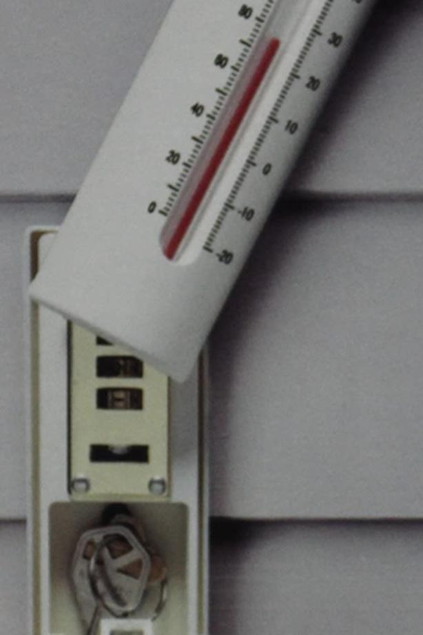Disguised outside thermometer key safe